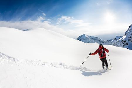 european alps: Skiing: male skier in powder snow. Italian Alps, Europe.