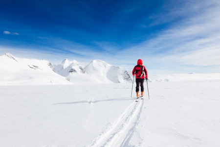 Mountaineer walking on a glacier during a high-altitude winter expedition in the european Alps. Breithorn, Monte Rosa massif, Valle d Stock Photo