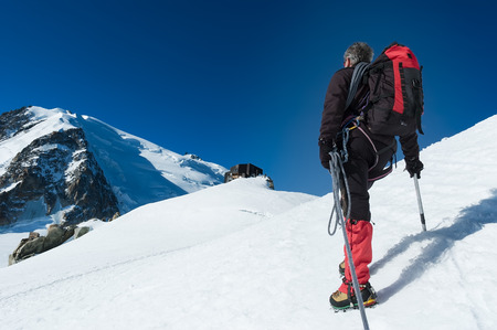 Mountaineer walking on the glacier during the climb of Mont Blanc. Chamonix, west Alps, France, Europe. photo