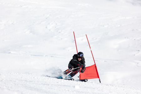 Young ski racer during a slalom competition. Stock Photo