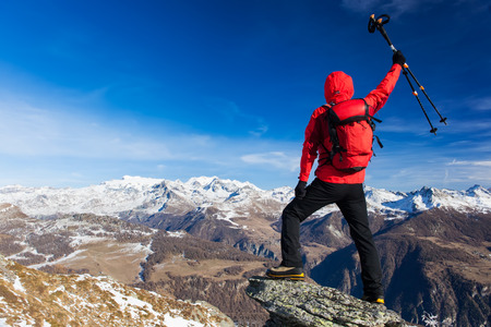 mountaineer: Rear view of a hiker that shows enthusiasm raising his arms. Concepts: victory, success, achievement, triumph. Monte Rosa Massif, Valle dAosta, Italy, Europe. Stock Photo