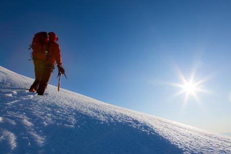 clear sky: Climber walks on a glacier. Winter season, clear sky. Western italian Alps, Italy, Europe. Stock Photo