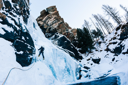 icefall: Ice climbing: male climber on a icefall in italian Alps. Cogne (Val dAosta) - Italy. Stock Photo