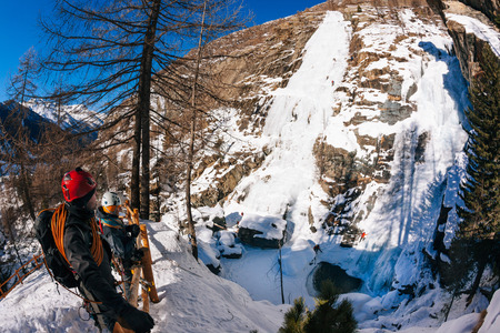 icefall: Lillaz icefall: ice climbing paradise. Concepts: extreme sport, vacation, adventure travel. European Alps, Cogne Val dAosta - Italy. Stock Photo
