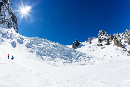 blanche: CHAMONIX, FRANCE - MARCH 19, 2016: a group of skiers go downhill in front of the giant icefall of Valle Blanche. Mont Blanc, Chamonix, France, Europe. Stock Photo