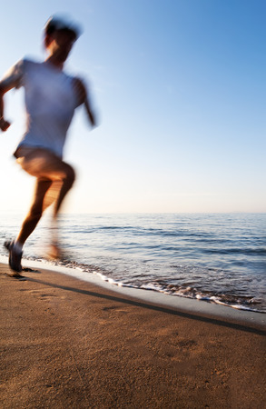 blur effect: Young man running on a beach at sunrise. Motion blur effect. Concepts: well-being, vitality, healthy life, vacation, sport, training