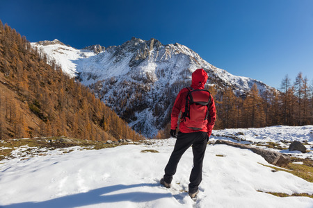 Man is backpacking in winter mountains. Piemonte, Italian Alps, Europe. Concepts: vacation, adventure, hiking, enterprise, self realization. Banco de Imagens