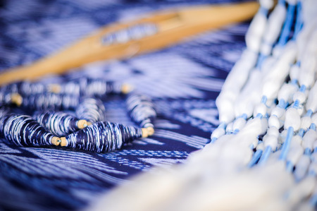 Original thai silk handwoven,Close up of wooden thread spinning with blue an white thread on loom.