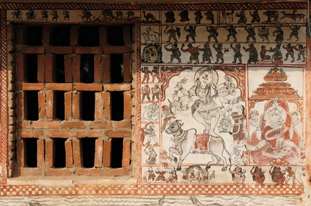 Colourful painting of a village wall of Orissa., India