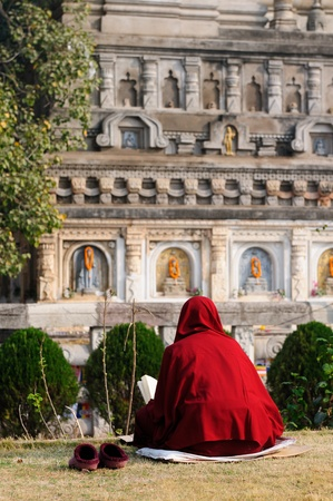 Buddhistic monk. Mahabodhy Temple in Bodhgaya, Bihar, India.  photo