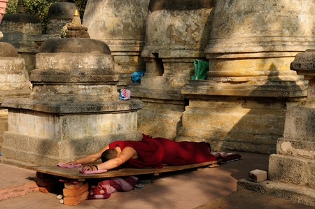 Buddhistic monk prayer. Mahabodhy Temple in Bodhgaya, Bihar, India.  photo