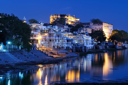 Viev on the City Palace on the night, Udajpur, India. Rajasthan Stock Photo