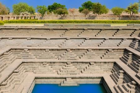 Pushkarani well in Hampi ruins, Karnataka, India photo