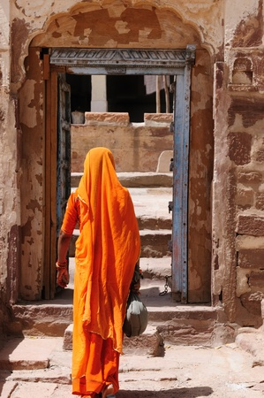 Color full Indian women with sari, in front to old gate to the fort. India photo
