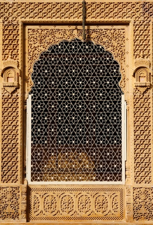 Ornate window of beautifolu Haveli in Jaisalmer city in India. Rajasthan.    photo