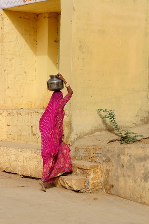 water well: Ethnic women going for the water in well. Rajasthan, India.