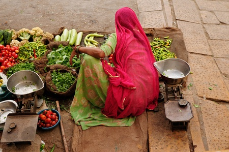Indian Colorfully women seling the vegetables on the street photo