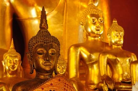 Buddha statue inside Wat Phan Tao  temple - Chiang Mai, Thailand photo