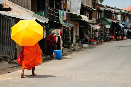 A Cambodian monk walking no the street in Phnom Penh Stock Photo