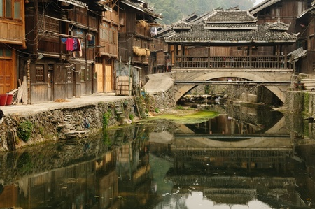 Zhaoxing - gorgeous Dong village is packed whit traditional wooden structures, several wind-and-rain bridges and remarkable drum towers, China. Guizhou province Stock Photo - 12100126