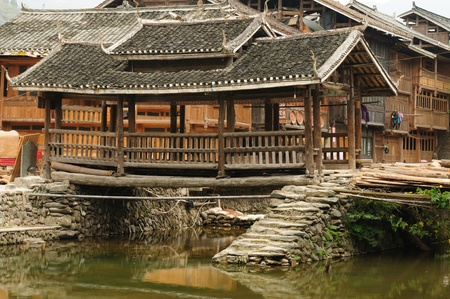 dong: Zhaoxing - gorgeous Dong village is packed whit traditional wooden structures, several wind-and-rain bridges and remarkable drum towers, China. Guizhou province