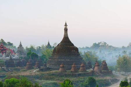 Myanmar (Burma), Mrauk U temples. Ratanabon Paya (stupa) - this massive stupa is ringed by 24 smaller stupas. It was apparently built by Queen Shin Htway in 1612.  Stock Photo - 12099870