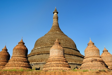 apparently: Myanmar (Burma), Mrauk U temples. Ratanabon Paya (stupa) - this massive stupa is ringed by 24 smaller stupas. It was apparently built by Queen Shin Htway in 1612.