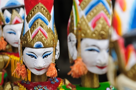 Souvenir from Bali island - traditional wood painting puppet. Indonesia.  Standard-Bild