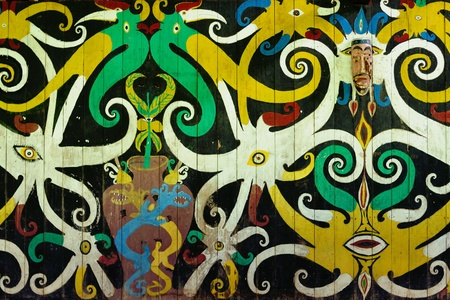 borneo: Traditional Dayak tribal culture. Ancient detail painting of the Dayak house - longhouse in Long Hubung village. East Kalimantan, Indonesia, Borneo.