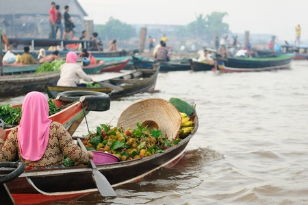 Banjarmasin - Kalimantan's largest and most beguiling city rest gingerly over a labyrinth of canals. Floating market near the city on the Martapura river. Indonesia, Borneo Editorial