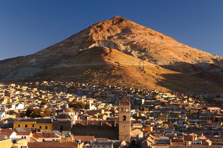 Potosi in Bolivia - the world s highest city  4070m   Potosi is set against the backdrop of a ranbow-colored mountain - Cerro Rico  Cityscape - Cerro Rico and roftop view from Cathedral Stock Photo
