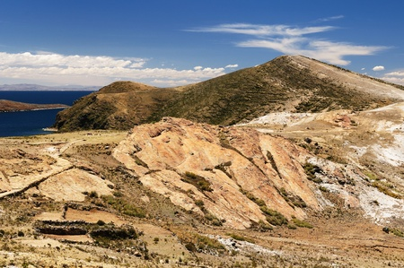 Bolivia � Inca prehistoric ruins on the Isla del Sol, on the Titicaca lake, the largest highaltitude lake in the world  3808m  This photo present the sacred Puma rock photo