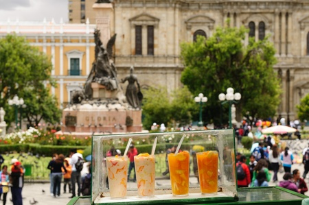 the fruitful: La Paz - the governmental capital of Bolivia  Cityscape - Plaza Pedro De Murillo, main squer in town - fresh fruitful coctails selling on the squer