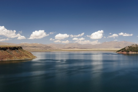 threatened: Umayo Lake which is home to a wide variety of plants and Andean waterbirds, plus a small island with vicunas   threatened, wild relatives of Ilamas   The Lake Titicaca area in Peru