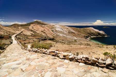 Bolivia   Inca prehistoric ruins on the Isla del Sol, on the Titicaca lake, the largest highaltitude lake in the world  3808m   Inca trail and sacred Puma rock Stock Photo - 13411983