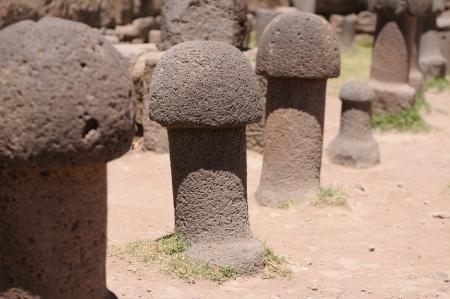 phallus: Stone phallus in temple de la Fertilidad, Peru. An Inca prehistoric ruins in Chucuito near Puno, Titicaca lake area.   Stock Photo