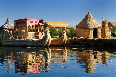 Peru, floating Uros islands on the Titicaca lake, the largest highaltitude lake in the world (3808m). Theyre built using the buoyant totora reeds that grow abundantly in the shallows of the lake. photo