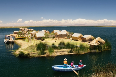 Peru, floating Uros islands on the Titicaca lake, the largest highaltitude lake in the world  3808m   Theyre built using the buoyant totora reeds that grow abundantly in the shallows of the lake  photo
