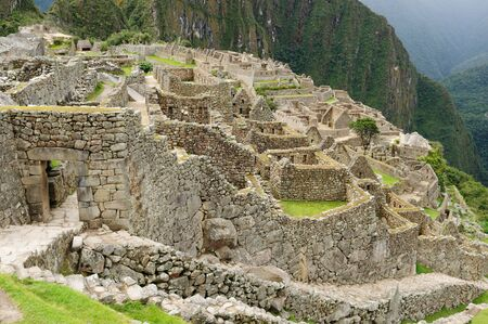 the lost city of the incas: Peru, Machu Picchu the lost ancient incas town. Main gate to fhe city Stock Photo