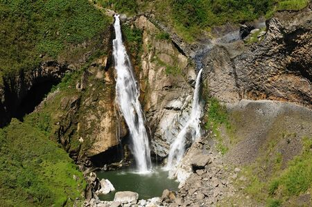 Beautiful waterfall in cloud forest near Banos, one of Ecuadors most enticing and popular tourist destination.  photo