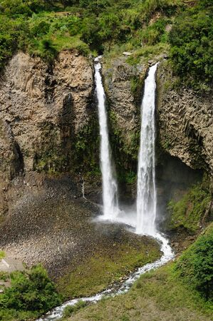 Beautiful waterfall in cloud forest near Banos, one of Ecuadors most enticing and popular tourist destination Stock Photo - 15796584