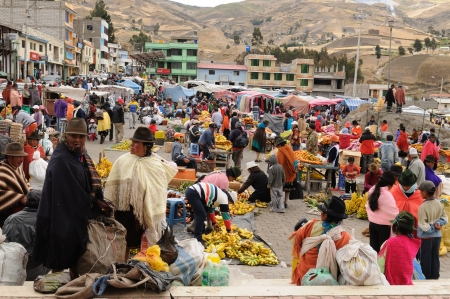 indian artifacts: Ecuador, Pujili - August 11  Ecuadorian ethnic peoples in national clothes selling agricultural products and other food items on a market in the Pujili village on August 11, 2012 in Pujili
