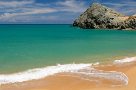 azucar: Colombia, wild coastal desert of Penisula la Guajira near  the Cabo de la Vela resort  The picture present beautiful Pilon de Azucar beaches of the Caribbean coast with turquoise water and orange sand
