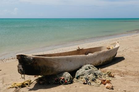 Colombia, wild coastal desert of Penisula la Guajira near  the Cabo de la Vela resort  The picture present traditional fishing boat made of the one-piece tree photo