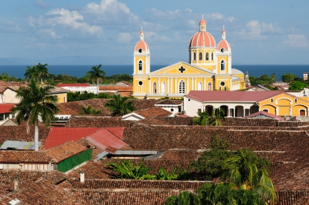 Granada - the colonial oldest Spanish city in Nicaragua has trim churches, the fine palm-covered plaza, and the colorful architecture  The picture present view on the colonial old town in Granada