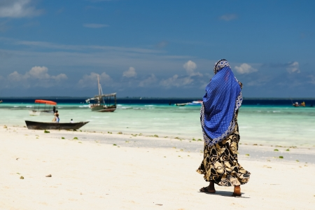 Tanzania, Ethnic women on the beautiful beach on the  Zanzibar island photo