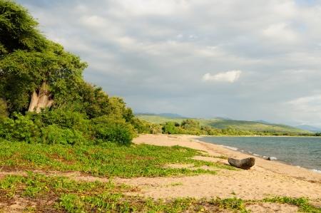 the deepest: Tanzania, el lago Tanganyika es el m?s largo del mundo y el segundo m?s profundo lago de agua dulce, tambi?n es uno de los lagos m?s antiguos del planeta La imagen presenta hermosa playa de arena y barcos tradicionales
