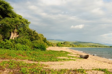 tanganyika: Tanzania, Tanganyika lake  is the Worlds longest and second deepest fresh water lake, it is also one of the oldest lakes on the planet  The picture presents beautiful sand beach and traditional boats Stock Photo
