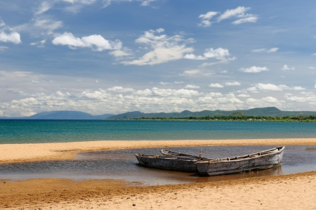 Tanzania, Tanganyika lake  is the Worlds longest and second deepest fresh water lake, it is also one of the oldest lakes on the planet  The picture presents beautiful sand beach and traditional boats Banco de Imagens