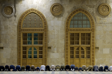 muslim prayer: Muslims say prayes in old mosque in Damascus, Syria, first position  1